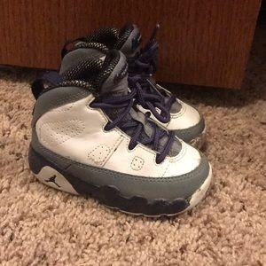 White, grey and purple Jordan's